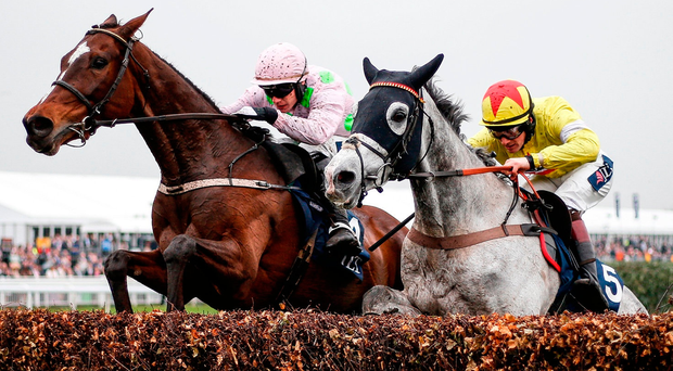 Sam Twiston-Davies on board Politologue (right) clears the last to win The JLT Melling Chase from Min and Paul Townend at Aintree yesterday. Photo: Alan Crowhurst/Getty Images