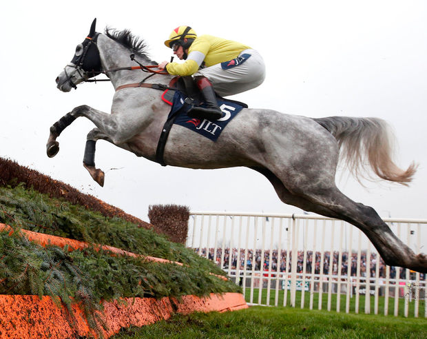 Politologue ridden by Sam Twiston-Davies on their way to victory in the JLT Melling Chase at Aintree. Photo: Reuters/Matthew Childs