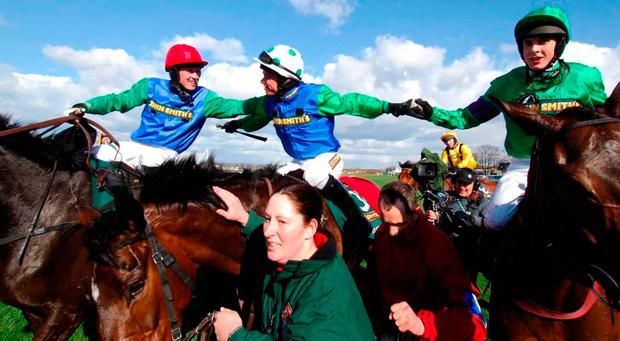 Timmy Murphy (centre) celebrates his 2008 Grand National victory on Comply Or Die with Johnny Farrelly (left) and Aidan Coleman
