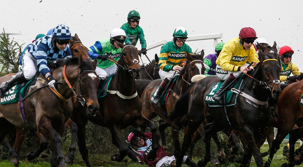Jockey Jonathan Moore falls from Newsworthy at 'The Chair' at Aintree yesterday, a fence which 40 horses and jockeys will have to jump if they are to take glory in the Grand National today. Photo: Getty Images
