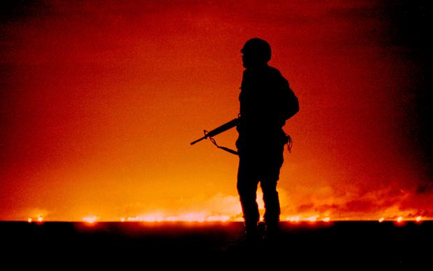Born in the USA: Elizabeth Bruenig came into the world during the first Gulf War in 1991, where a soldier looks on as the Kuwaiti oil fields burn after Saddam Hussein's Iraqi forces set them ablaze