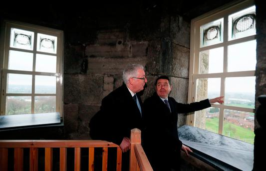 Finance Minister Paschal Donohoe (left) and Glasnevin Trust chairman John Green look out from O'Connell Tower. Photo: PA Wire