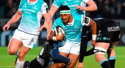 Bundee Aki of Connacht is tackled by Rob Harley of Glasgow Warriors