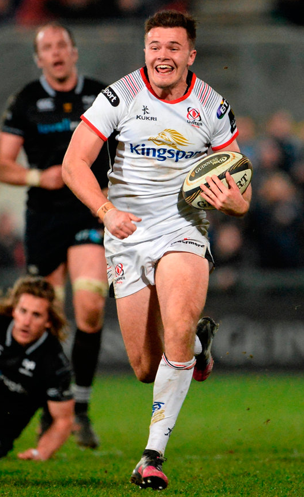 Ulster's Jacob Stockdale on his way to scoring his side's try in the final minute of the match against the Ospreys. Photo: Oliver McVeigh/Sportsfile