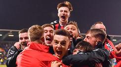 Darragh Leahy, centre, celebrates with team-mates after scoring the winner for Bohemians against Shamrock Rovers in Tallaght last night. Photo: Sportsfile