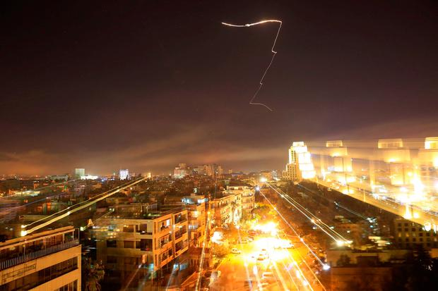 Damascus is seen as the US launches an attack on Syria targeting different parts of the capital early Saturday. Syria's capital has been rocked by loud explosions that lit up the sky with heavy smoke as US President Donald Trump announced airstrikes in retaliation for the country's alleged use of chemical weapons. Photo: AP