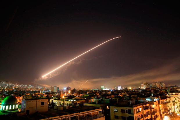 Damascus sky lights up with service to air missile fire as the US launches an attack on Syria targeting different parts of the Syrian capital Damascus, Syria, early Saturday, April 14, 2018. Syria's capital has been rocked by loud explosions that lit up the sky with heavy smoke as US President Donald Trump announced airstrikes in retaliation for the country's alleged use of chemical weapons. Photo: AP
