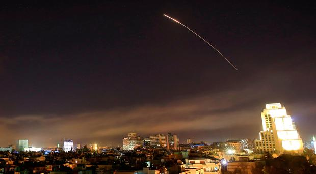 Damascus skies erupt with missile fire as the U.S. launches an attack on Syria targeting different parts of the capital Syria, early Saturday, April 14 (AP Photo/Hassan Ammar)