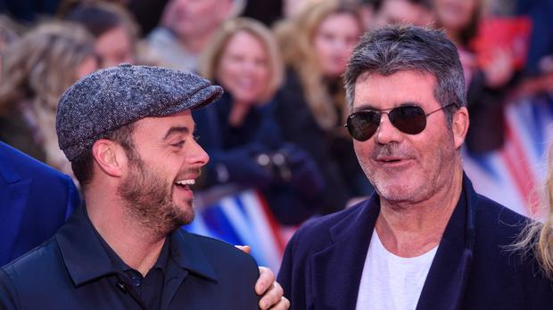 Anthony McPartlin and Simon Cowell (Matt Crossick/PA)