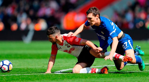 SOUTHAMPTON, ENGLAND - APRIL 14: Shane Long of Southampton is challenged by Andreas Christensen of Chelsea during the Premier League match between Southampton and Chelsea at St Mary's Stadium on April 14, 2018 in Southampton, England. (Photo by Warren Little/Getty Images)