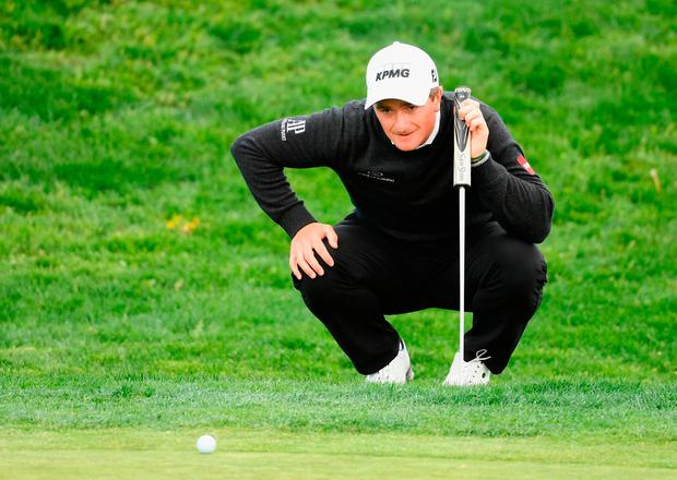 MADRID, SPAIN - APRIL 13: Paul Dunne of Ireland lines up his putt on the 8th green during day two of the Open de Espana at Centro Nacional de Golf on April 13, 2018 in Madrid, Spain. (Photo by Ross Kinnaird/Getty Images)