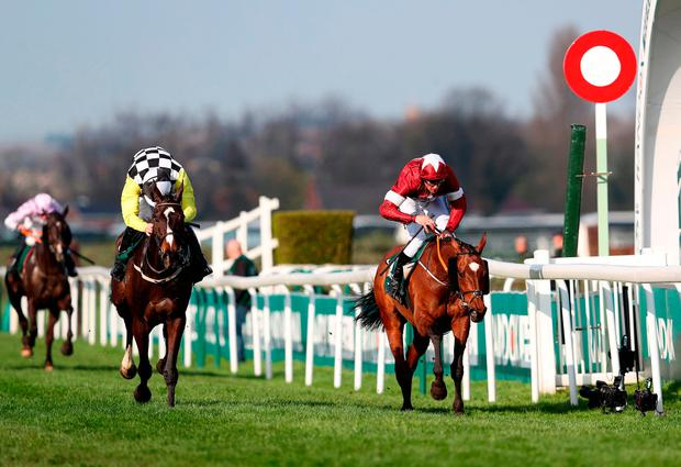 Tiger Roll ridden by jockey Davy Russell (right) wins the Randox Health Grand National Handicap Chase ahead of Pleasant Company ridden by jockey David Mullins during Grand National Day of the 2018 Randox Health Grand National Festival at Aintree Racecourse, Liverpool. David Davies/PA Wire