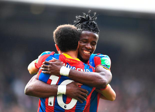 Soccer Football - Premier League - Crystal Palace vs Brighton & Hove Albion - Selhurst Park, London, Britain - April 14, 2018 Crystal Palace's Wilfried Zaha and Andros Townsend celebrate after the match. REUTERS/Dylan Martinez