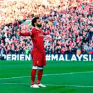 Liverpool's Mohamed Salah celebrates scoring his side's second goal of the game during the Premier League match at Anfield, Liverpool. Saturday April 14, 2018. Anthony Devlin/PA Wire.