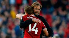 Soccer Football - Premier League - Liverpool vs AFC Bournemouth - Anfield, Liverpool, Britain - April 14, 2018 Liverpool manager Juergen Klopp and Jordan Henderson celebrate after the match. REUTERS/Andrew Yates