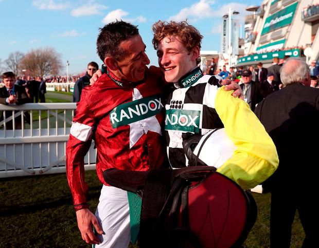 Tiger Roll jockey Davy Russell (left) and Pleasant Company jockey David Mullins after finishing first and second respectively. Photo: David Davies/PA Wire