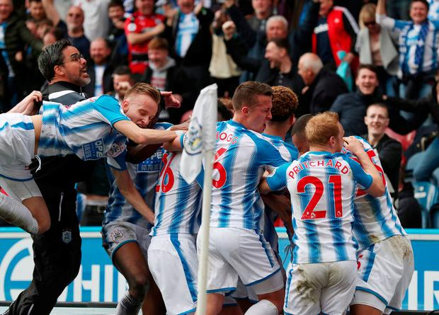 Huddersfield Town's Tom Ince celebrates with teammates and manager David Wagner. Photo: Scott Heppell/Reuters