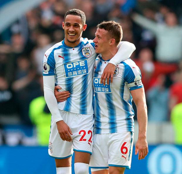 Huddersfield Town's Tom Ince celebrates with Jonathan Hogg. Photo: Scott Heppell/Reuters