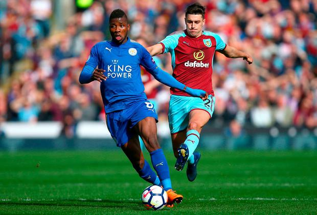 Leicester City's Kelechi Iheanacho (left) and Burnley's Matthew Lowton. Photo: Dave Thompson/PA Wire