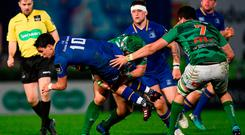 Joey Carbery of Leinster is tackled by Luca Bigi of Benetton