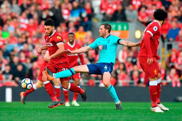 Liverpool's Alex Oxlade-Chamberlain goes past AFC Bournemouth's Dan Gosling. Photo: Anthony Devlin/PA Wire