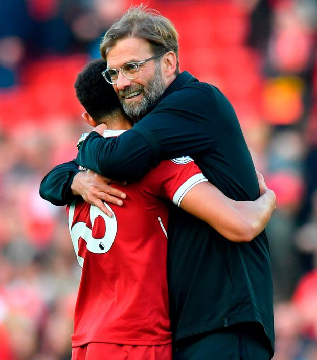 Liverpool manager Jurgen Klopp embraces Liverpool's Trent Alexander-Arnold. Photo: Anthony Devlin/PA Wire
