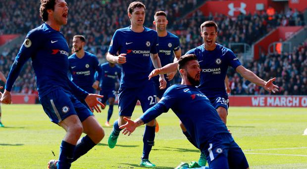 Chelsea's Olivier Giroud celebrates scoring their third goal with Marcos Alonso, Cesar Azpilicueta and team mates. Photo: Ian Walton/Reuters