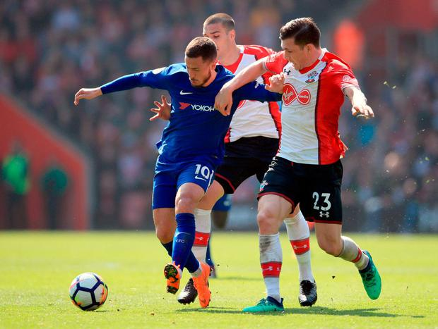 Chelsea's Eden Hazard (left) and Southampton's Pierre-Emile Hojbjerg battle for the ball. Photo: Adam Davy/PA Wire