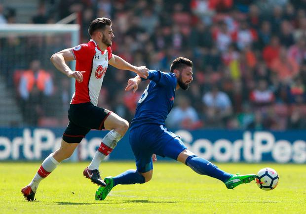 Chelsea's Olivier Giroud in action with Southampton's Wesley Hoedt. Photo: Ian Walton/Reuters