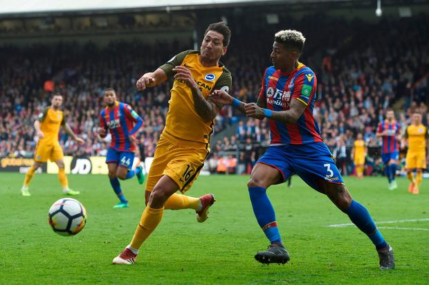 Brighton's Leonardo Ulloa in action with Crystal Palace's Patrick van Aanholt. Photo: Alan Walter/Action Images via Reuters
