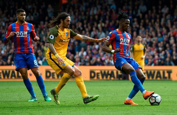 Crystal Palace's Wilfried Zaha in action with Brighton's Ezequiel Schelotto. Photo: Alan Walter/Action Images via Reuters