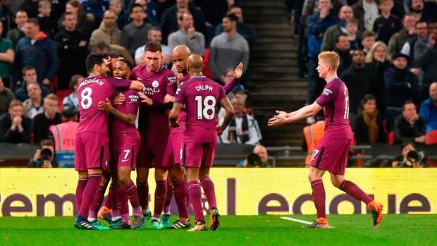 Manchester City's Raheem Sterling celebrates scoring his side's third goal