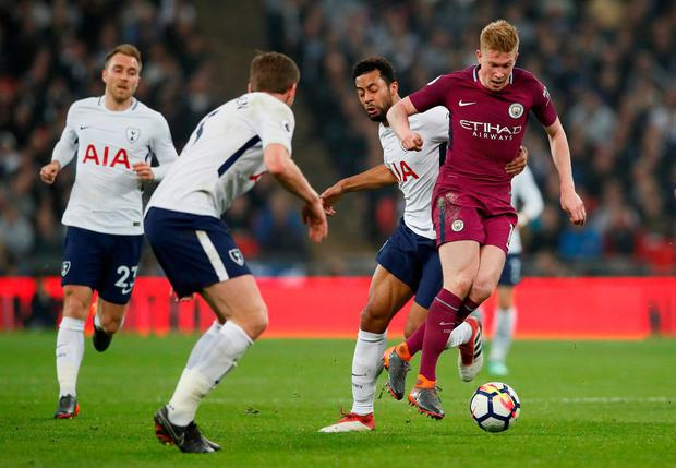 Manchester City's Kevin De Bruyne in action with Tottenham's Mousa Dembele. Photo: David Klein/Reuters