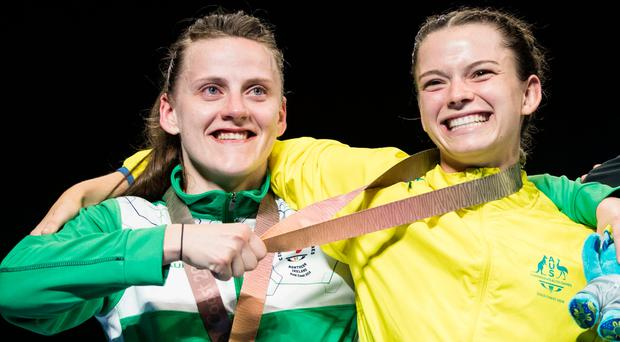 Left to right Northern Ireland's Michaela Walsh (silver) shares a joke with Australia's Skye Nicolson (gold) during the medal presentation ceremony after the Woman's Feather (54-57kg) final. Photo: Danny Lawson/PA