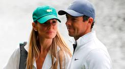 FUTURE IS BRIGHT: Rory McIlroy walks with his wife Erica Stoll during practice for the 2018 Masters golf tournament. Picture: Reuters