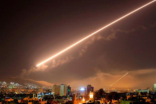 Damascus skies erupt with service to air missile fire as the U.S. launches an attack on Syria targeting different parts of the Syrian capital Damascus. Photo: Hassan Ammar/AP Photo