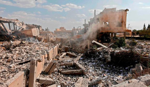 A picture showing the wreckage of a building described as part of the Syrian Scientific Studies and Research Centre (SSRC) compound in the Barzeh district, north of Damascus, during a press tour organised by the Syrian information ministry yesterday. Photo: Louai Beshara/AFP/Getty Images