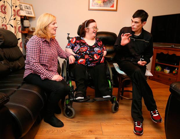 Labour of love: Noeleen Cullen is a victim of budget cuts to support services as she looks after her two children, Mandy and Aaron, at their home in Jobstown