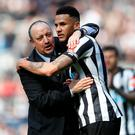 Newcastle United manager Rafael Benitez and Jamaal Lascelles celebrate