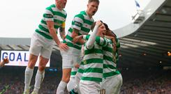 Celtic's Moussa Dembele (obscured) celebrates scoring his side's third goal