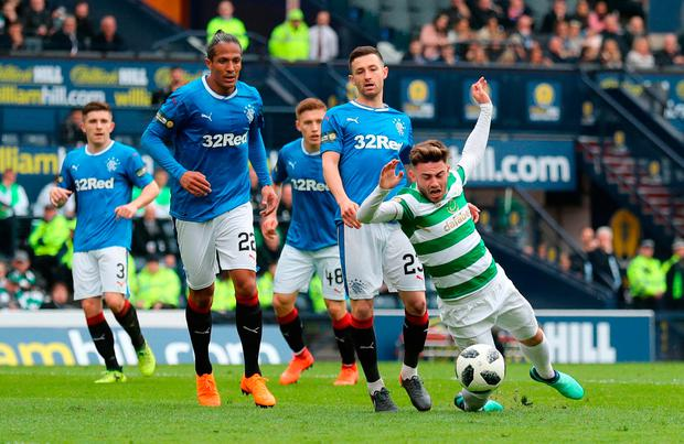Celtic's Patrick Roberts is brought down inside the box for Celtic's second penalty