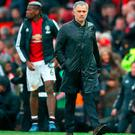Manchester United manager Jose Mourinho leaves the pitch after the final whistle