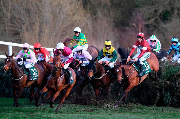 Tiger Roll (No 13) and Davy Russell take the inside route at the Canal Turn on their way to victory in Saturday's Grand National. Photo: Getty Images