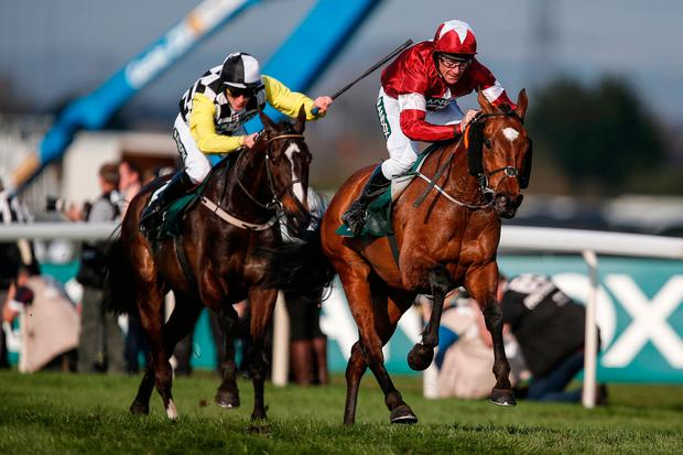 Tiger Roll and Davy Rusell (right) hold off the late thrust of Pleasant Company under David Mullins. Photo: Getty Images