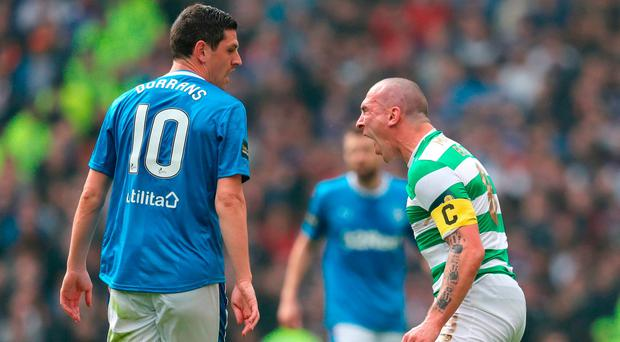 Celtic's Scott Brown screams at Rangers' Graham Dorrans. Photo: Andrew Milligan/PA Wire