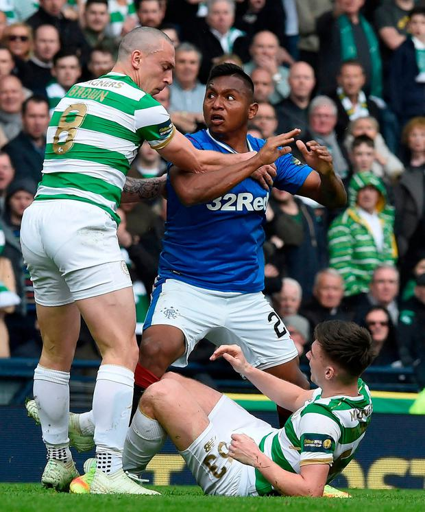 Celtics Scott Brown and Rangers Alfredo Morelos clash after Morelos attempts to get the ball from Celtics Kieran Tierney. Photo: Ian Rutherford/PA Wire