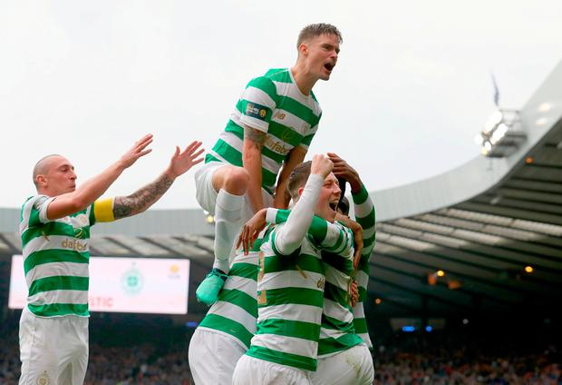 Celtic players celebrate after Moussa Dembele's penalty. Photo: Andrew Milligan/PA Wire