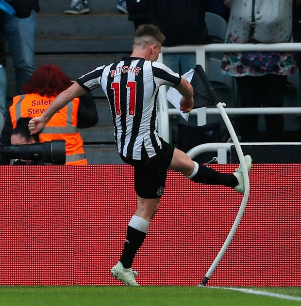 Matt Ritchie kicks the corner flag in Arsene Wenger (11 in 2005-06) celebration after his goal. Photo: Scott Heppell/Reuters