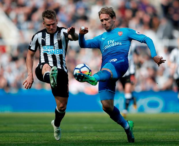 Arsenal's Nacho Monreal in action with Newcastle United's Matt Ritchie. Photo: Carl Recine/Action Images via Reuters