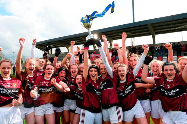 Loreto of Cavan team captains Muireann Cusack, left, and Niamh Keenaghan lift the cup as they celebrate after the Lidl All Ireland P-Primary School Senior. Photo: Sportsfile